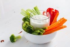 Vegetable sticks and yogurt dip stock photos