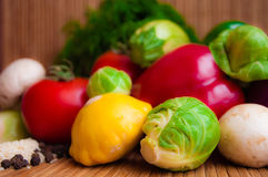 Vegetable still life. Brussels sprouts, Pattison, tomatoes and other vegetables for dietary royalty free stock photos