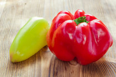 Vegetable still life of two mature red and green peppers Stock Photos