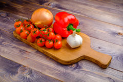 Vegetable still life on wood table. Background Stock Photography