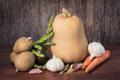 Vegetable still life on wooden background stock photo