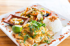 Vegetable stir-fry with rice. Traditional Balinese cuisine. Vegetable stir-fry, fish and rice Stock Image