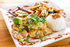 Vegetable stir-fry with rice. Traditional Balinese cuisine. Vegetable stir-fry, fish and rice Stock Photo