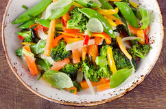 Vegetable stir fry on a wooden table. Royalty Free Stock Photos