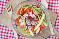 Vegetable summer zucchini or courgette salad with tomato Stock Photos