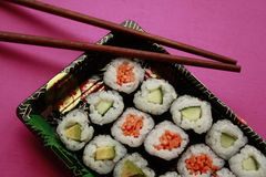 Vegetable sushi on blue plate Royalty Free Stock Images