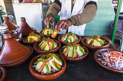 A vegetable tajine dish in Morocco. Moroccan tajine dishes are slow-cooked savory stews, typically made with sliced meat, poultry or fish together with royalty free stock images