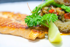 Vegetable tartar and grilled salmon stock photo