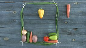 Vegetable Tetris on the old village table. Different vegetables fall from the top down and fill the frame from the bow. Play in tetris with vegetables stock video footage