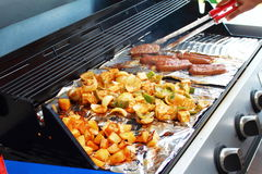 Vegetable tofu and hot dog grilling on grill Stock Images