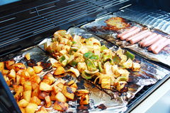 Vegetable tofu and hot dog grilling on grill Royalty Free Stock Images