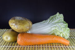 Vegetable. Tomato carrot and chinese Cabbage on Japanese mat Stock Image
