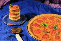 Vegetable tomato quiche. Small and large tomato tarts royalty free stock photography