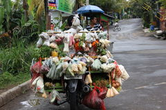 Vegetable Traders. Traveling by motorcycle Stock Image