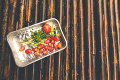 Vegetable in tray on the bamboo floor after raining. Used color tool for vintage tone Royalty Free Stock Photography