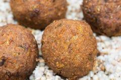 Vegetable vegan balls with buckweat graoats. On plate stock photo