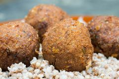 Vegetable vegan balls with buckweat graoats. On plate royalty free stock images