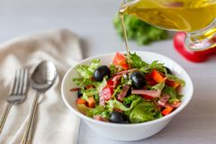 Vegetarian salad, from vegetables, with ham, and olive oil stock photos