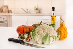 Vegetable on white board in kitchen Royalty Free Stock Photos