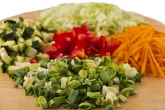 Vegetable on wooden plate,  on white Stock Images
