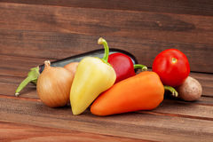 Vegetable on wooden table from board, vegetarian healthy food. Stock Photos