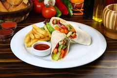 Vegetable Wrap with French Fries stock images