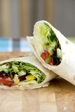 Vegetable wraps. With iceberg lettucr, peppers and red onion Stock Image