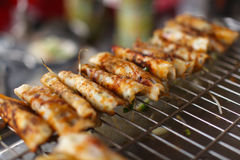 Vegetable wraps grilling at the food stall in Asia Royalty Free Stock Photography