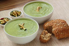 Vegetable zucchini soup. Creamy soup decorated by grilled pieces of courgette and wholegrain bread. Close up view. Vegetable zucchini soup puree ang grilled Stock Photos