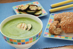 Vegetable zucchini soup puree served with grilled slices of zucchini and wholegrain bread. Close up view. Vegetable zucchini soup puree ang grilled slieces of Stock Image