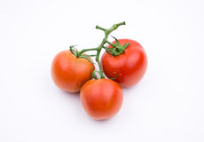 Vegetables:Together the three tomatoes Stock Photos