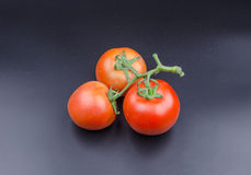 Vegetables:Together the three tomatoes Stock Image