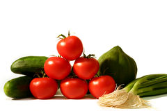 Vegetables. Cucumbers, tomatoes, pepper squash and onions Royalty Free Stock Image