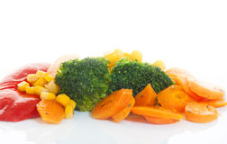 Vegetables. Steamed vegetables on  white background Royalty Free Stock Photo