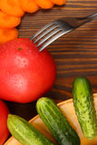 Vegetables. On table whith plug Royalty Free Stock Photography