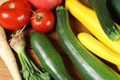 Vegetables. Fresh vegetables on the wooden board. Abundant crop Stock Images
