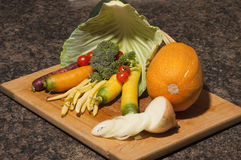 Vegetables. Arrangement of many different vegetables on a cutting board stock photography