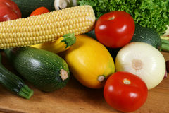 Vegetables. Fresh vegetables on the wooden board. Organic, healthy food Stock Photography