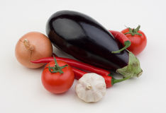 Vegetables. Onion tomato garlic eggplant Royalty Free Stock Images