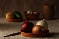 Vegetables,. Ceramic dish with bulbs  on a table Stock Photography