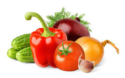 Isolated vegetables. Fresh tomato, bell pepper, onions, cucumbers, dill and garlic in heap isolated on white background royalty free stock photo