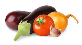 Isolated eggplants, tomato and onion. Fresh eggplants, tomato, onions and garlic isolated on white background Stock Photo