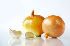 Onion and garlic. Still-life with vegetables on a light background Royalty Free Stock Images
