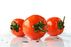 Fresh tomatoes. Still-life with tomatoes on a light background Stock Photo