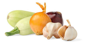 Vegetables. Zucchini, onions and garlic over white background royalty free stock image