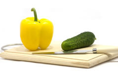 Vegetables. Pure vegetables lie on a chopping board Stock Photos