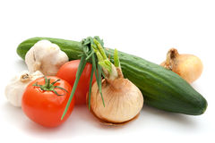 Vegetables. Cucumber, tomatoes, onions, garlic on white background royalty free stock photos