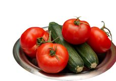 Vegetables. A bowl of vegetables, tomato and cucumber Royalty Free Stock Photos
