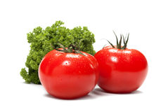 Vegetables. Freshly picked tomatoes and french parsley  on white background Stock Photo