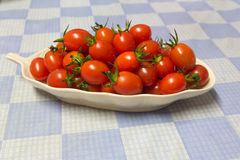 Vegetables. Fresh tomatoes, place in dish Royalty Free Stock Images